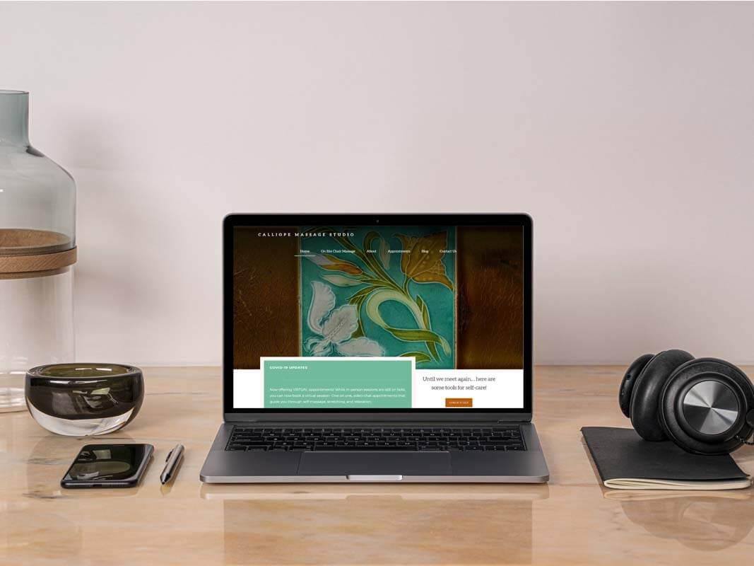 mockup of Calliope Massage Studio website on a laptop